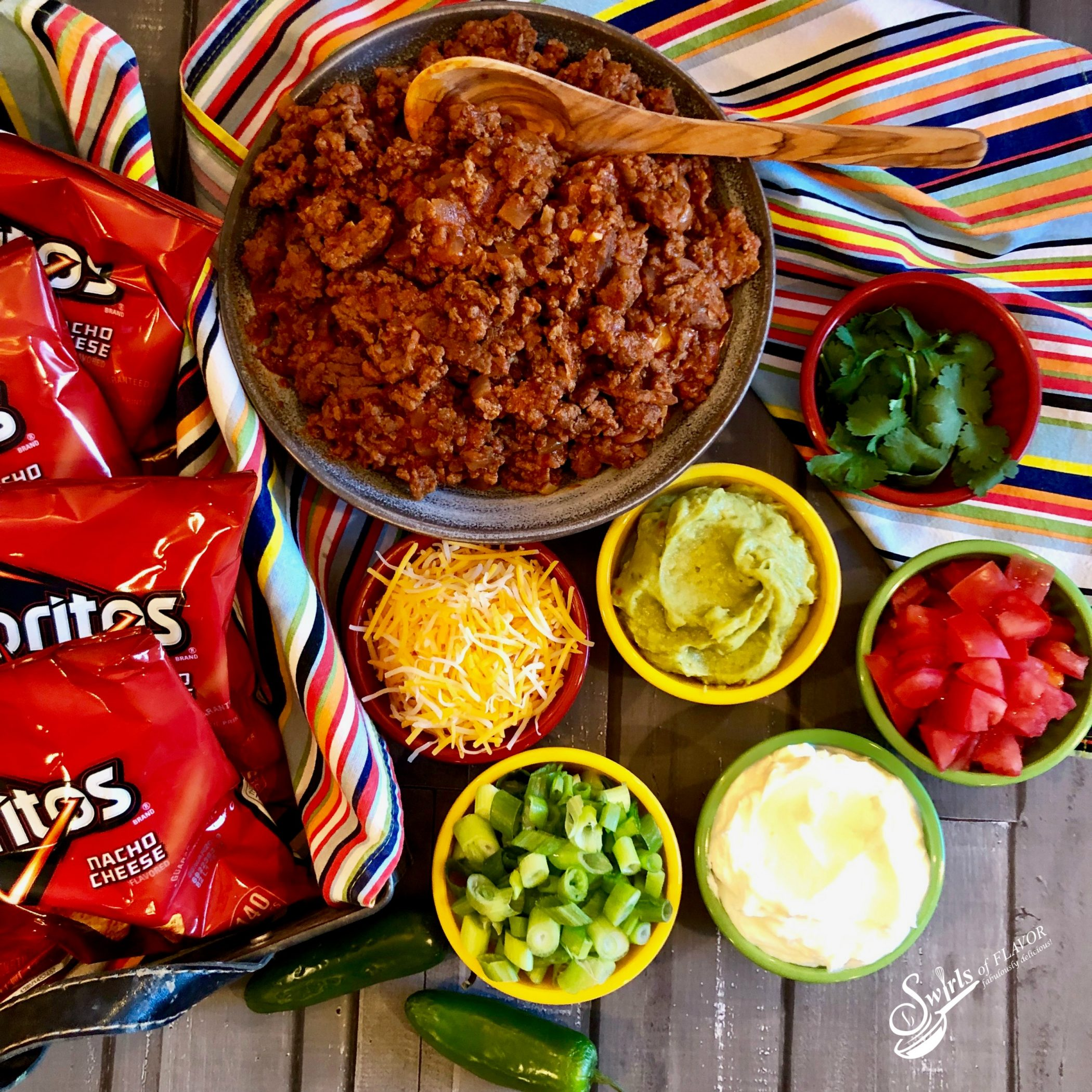 walking taco bar with taco filling and toppings