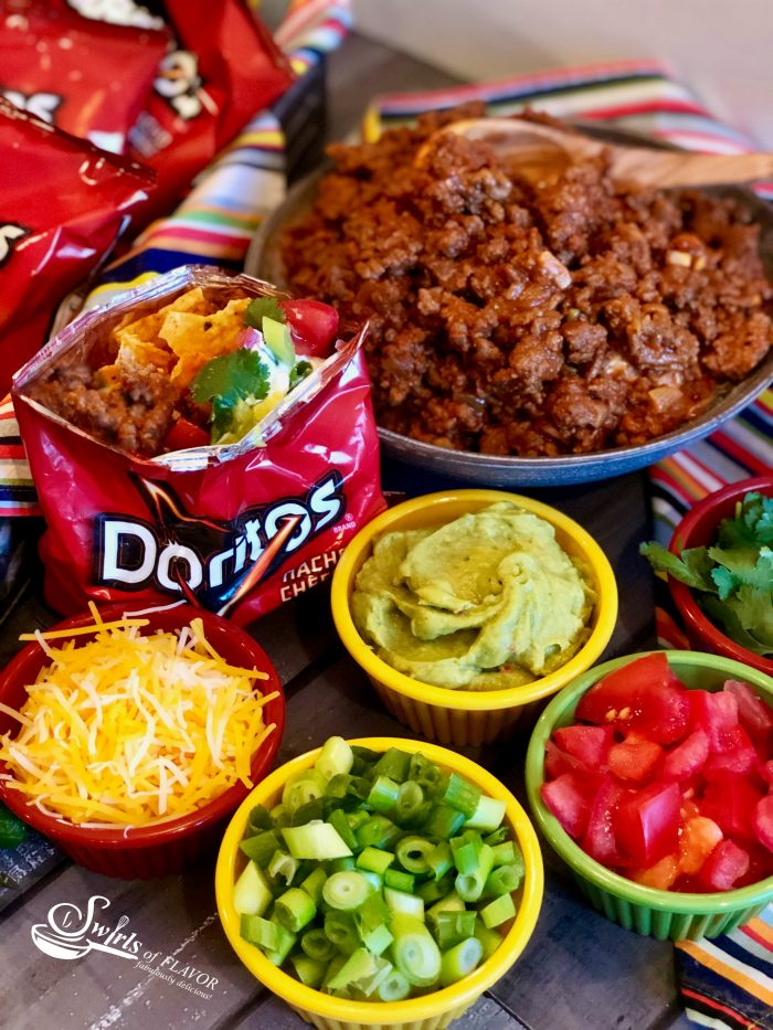 Our Walking Taco Bar is the perfect way to serve up a saucy taco filling and your favorite toppings for the big game. Crush the chips in your bag, top them with a flavorful beef taco filling, pile high with lots of taco toppings, add a plastic fork and you're all set! Your portable taco is in the bag for a fun and easy Super Bowl food with easy clean up too!
