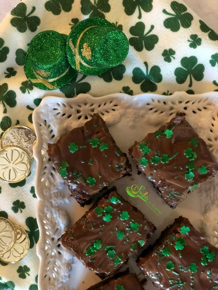 Homemade Chocolate Chip Mint Brownies, topped with a one ingredient mint frosting, is an easy dessert recipe for your Saint Patrick's Day celebration!
