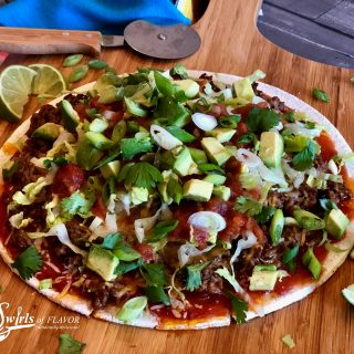 Taco Pizza With Cauliflower Crust puts a delicious twist on Taco Tuesday! Our pizza has all the fillings of a taco on a healthy cauliflower crust for a fun taco dinner that will quickly become a family favorite.