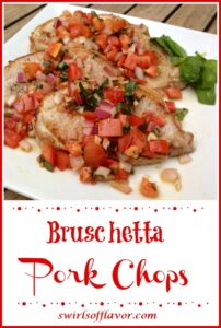 Pork chops with a tomato opiing on white dish