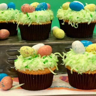 Easter Egg Coconut Cupcakes are homemade coconut cupcakes and coconut buttercream frosting decorated with shredded coconut and malted milk robin egg candy. A perfect Easter dessert!