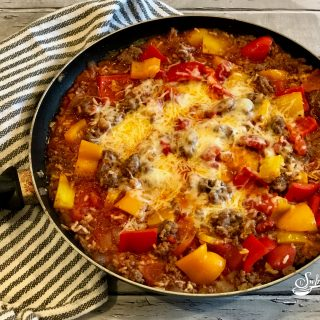 Ground beef, rice, bell peppers and seasonings cook together in one pot in less than 30 minutes in our One Pot Unstuffed Peppers With Rice recipe.