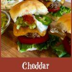 Mini cheeseburgers with jalapeno, guacamole, lettuce and tomato