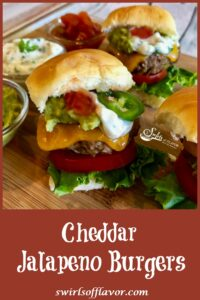 Mini cheeseburgers with jalapeno, guacamole, lettuce and tomato