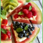 Watermelon pizza with to sices cut