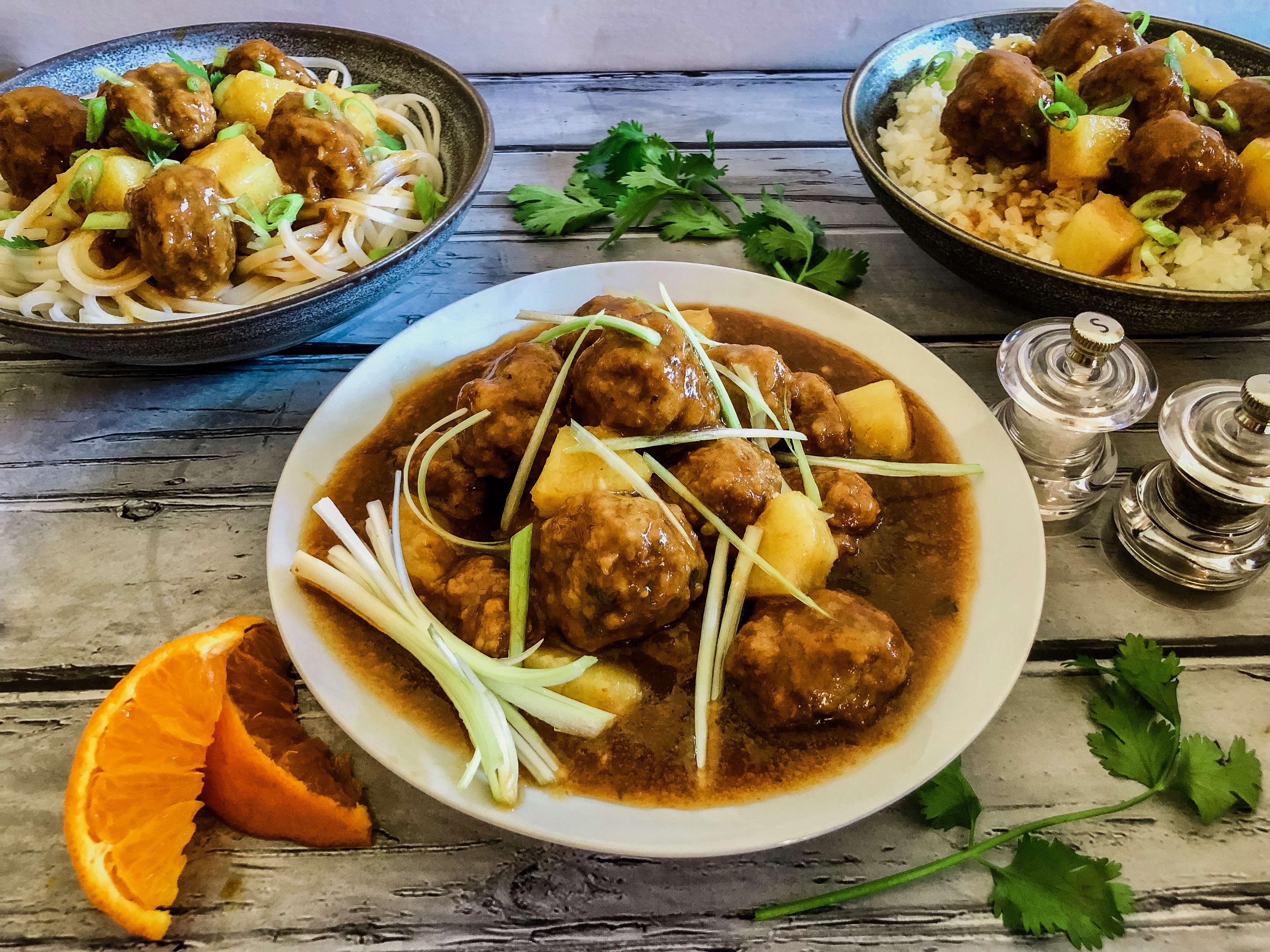 bowls of sweet and sour meatballs with noodles and rice