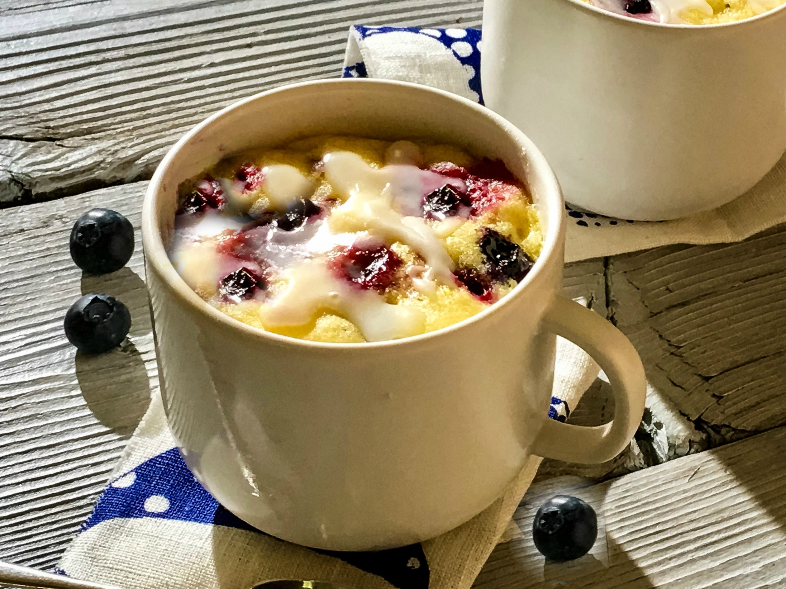 close up of a mug cake with blueberries