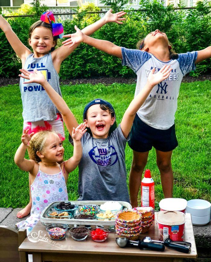 Happy kids at ice cream sundae party