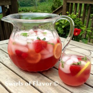 prosecco punch in pitcher and stemless glass