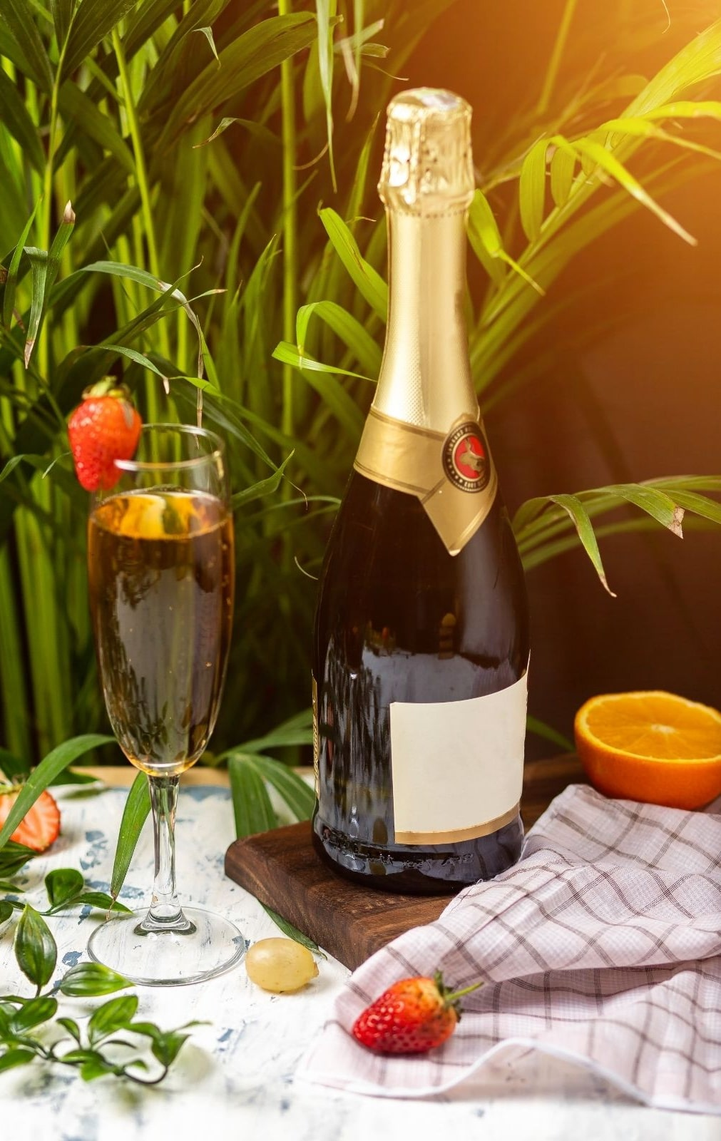 bottle of Prosecco with champagne flute glass and strawberry