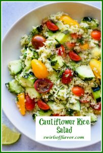Cucumber Tomato Cauliflower Rice Salad in a round white bowl