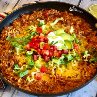 taco beef and rice in skillet with toppings