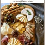 holiday cheese board with roasted grapes and text overlay