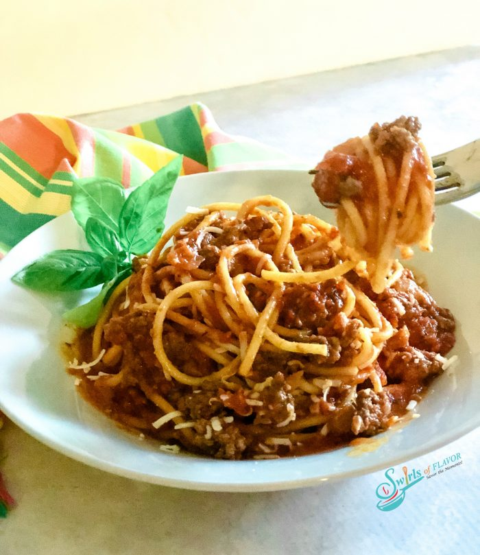 spaghetti with meat sauce and forkful of spaghetti