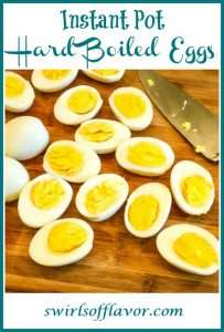 hard boiled eggs cut in half with knife and text overlay
