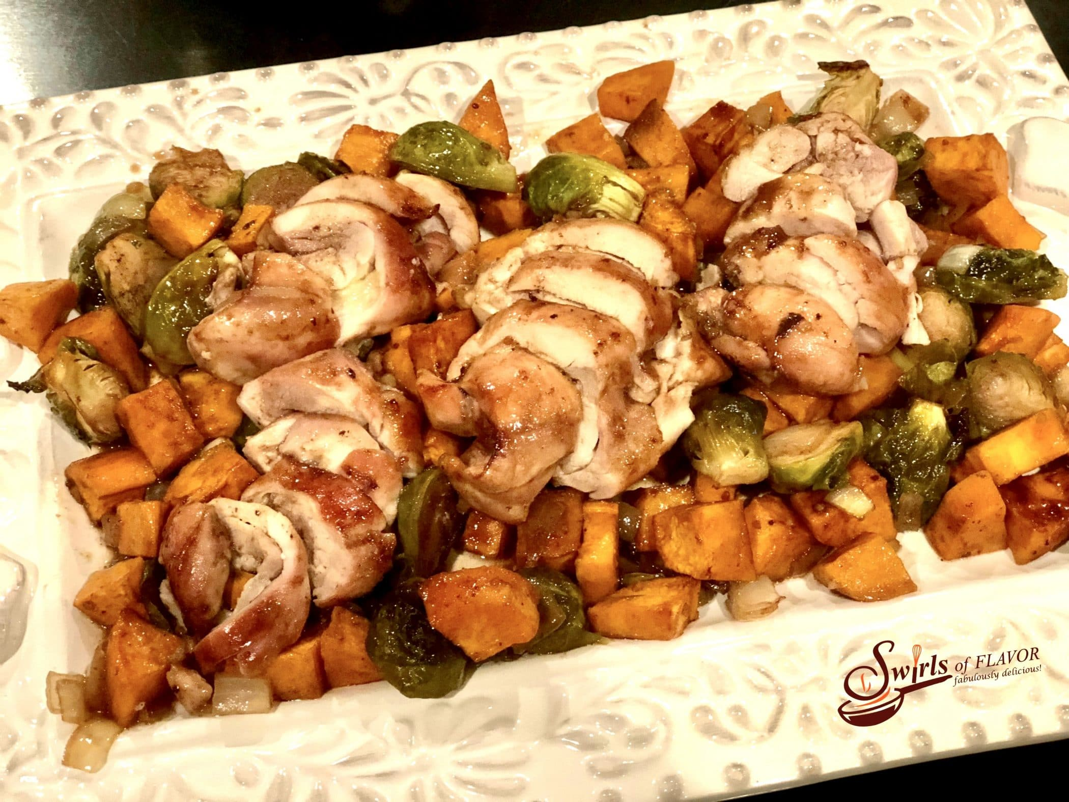 chhicken and sweet potatoes with brussels sprouts on white platter