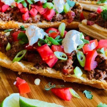 serving of stuffed taco bread on wooden board