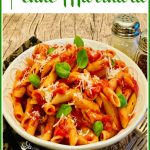 bowl of penne with tomato sauce and text overlay