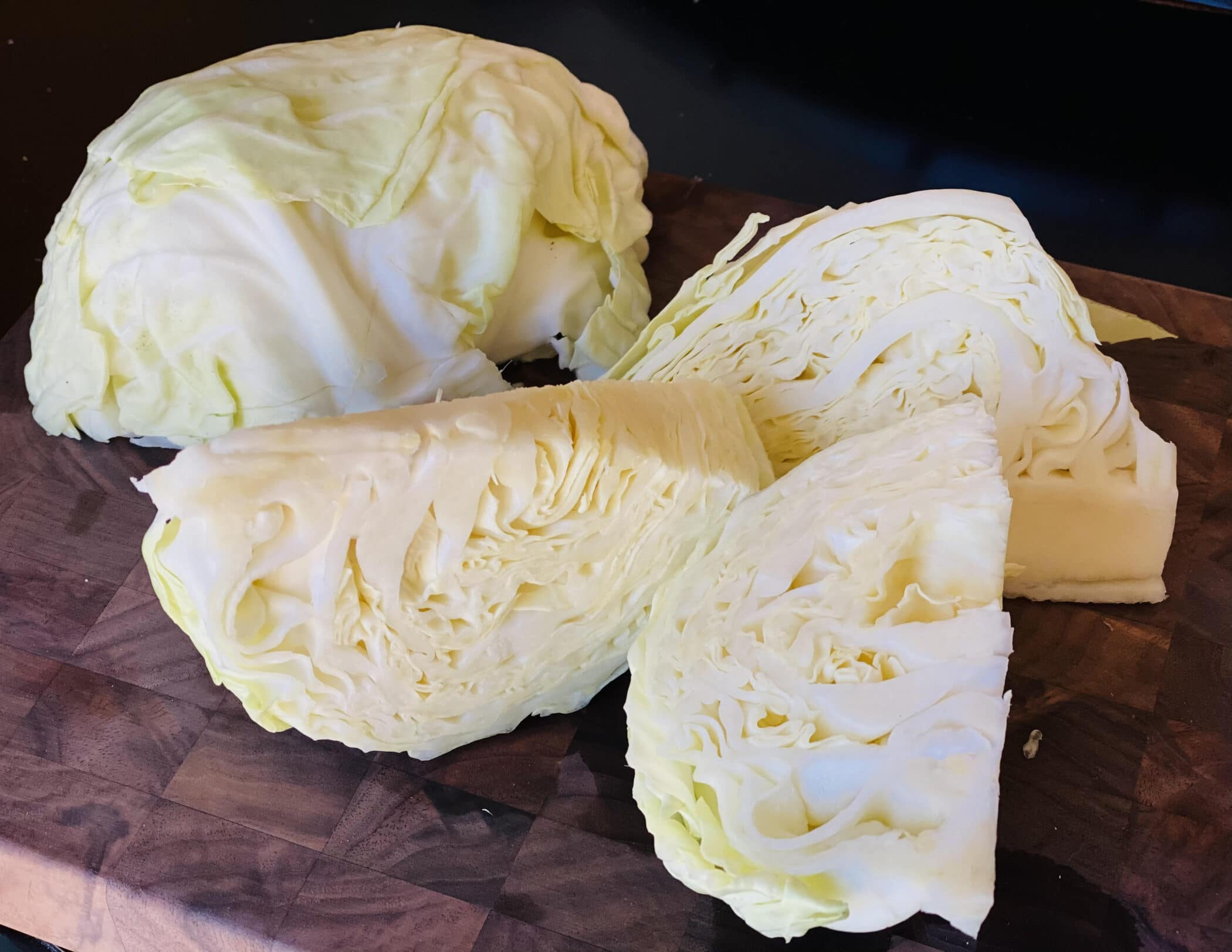 cabbage wedges on a cutting board
