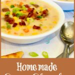Bowl of corn chowder soup with crumbled bacon and sliced scallions