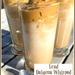 Three tall glasses of whipped iced coffee on table outside with spoons