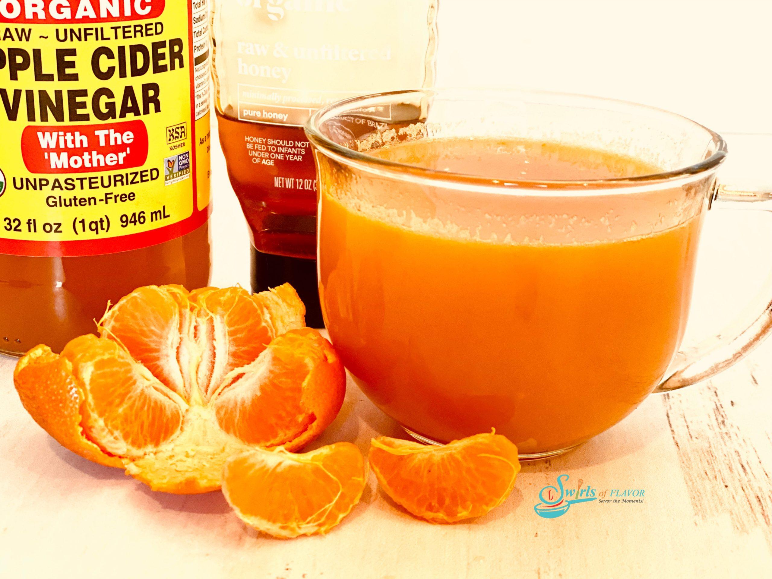 Vitamin C drink in mug with ingredients