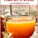 honey orange vitamin drink in mug with text overlay