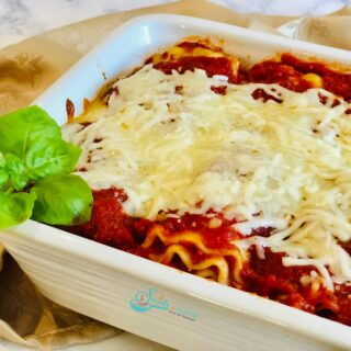 Lasagna roll dish ups in a white baking