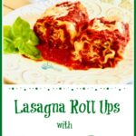Two lasagna roll ups with sauce on white dish