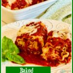 Two lasagna roll ups with fresh basil sprig on dish