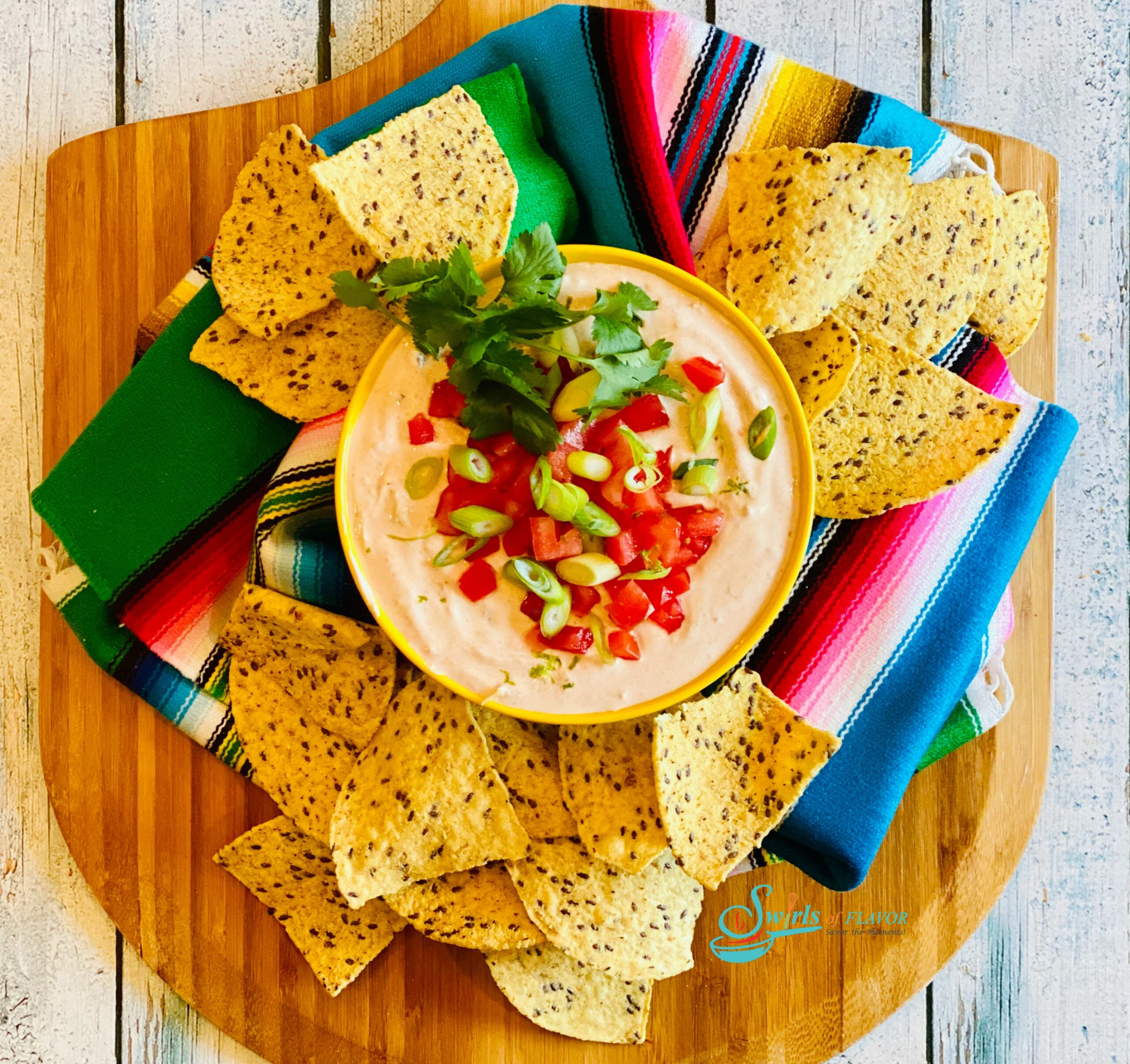 Salsa Dip on wooden board with chips