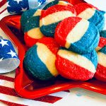 Red white and blue striped cookies on a red star plate