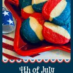 Red white and blue cookies on a rred star shaped plate