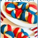 Red white and blue sugar cookies on a plate