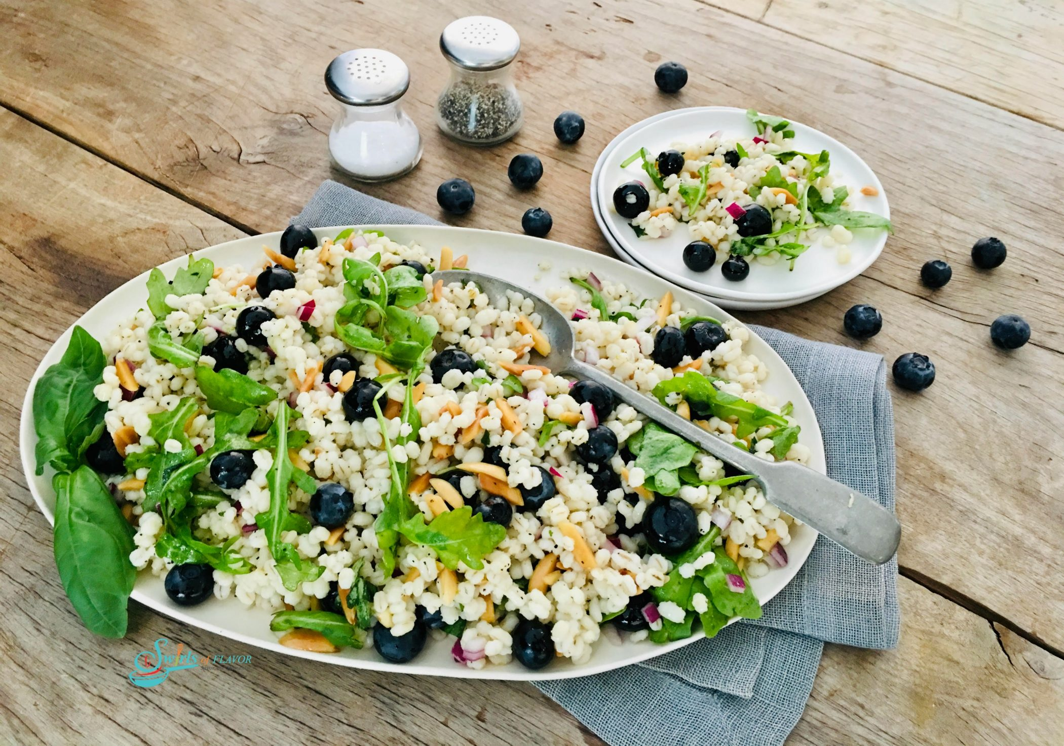 Baby greens with blueberries in a barley salad