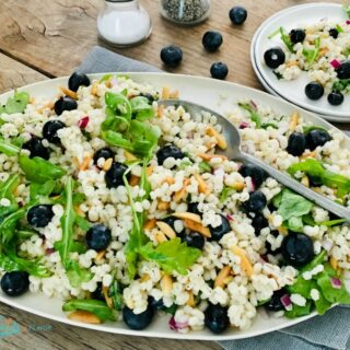 Barley Salad with blueberries on a white oval platter