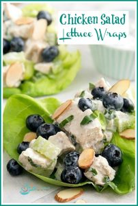 close up of chicken salad with blueberries and almonds in lettuce leaf