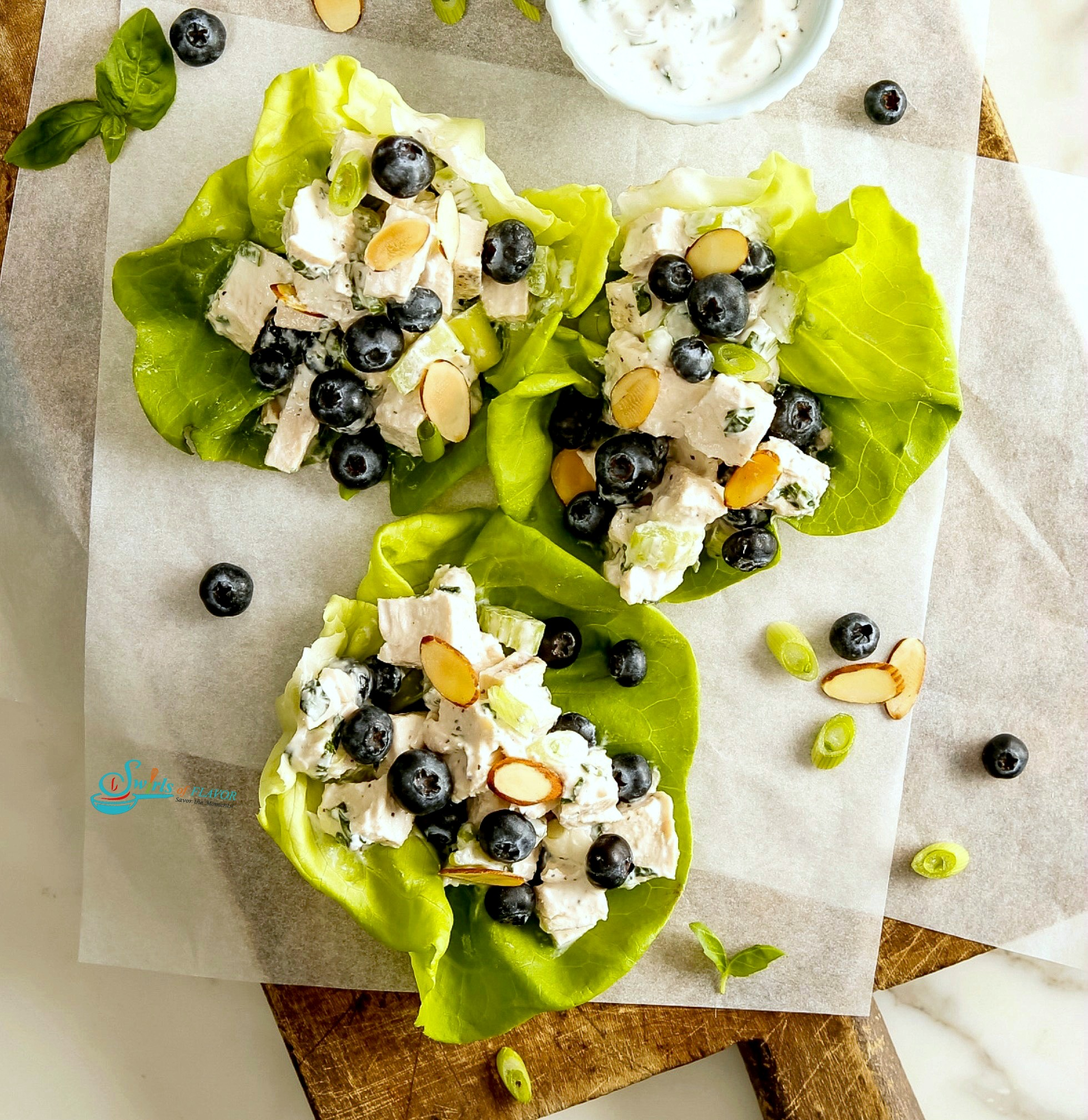 Chicken Salad lettuce wraps on a wooden board