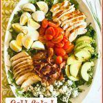 Overhead picture of a Cobb Salad in a white oval platter