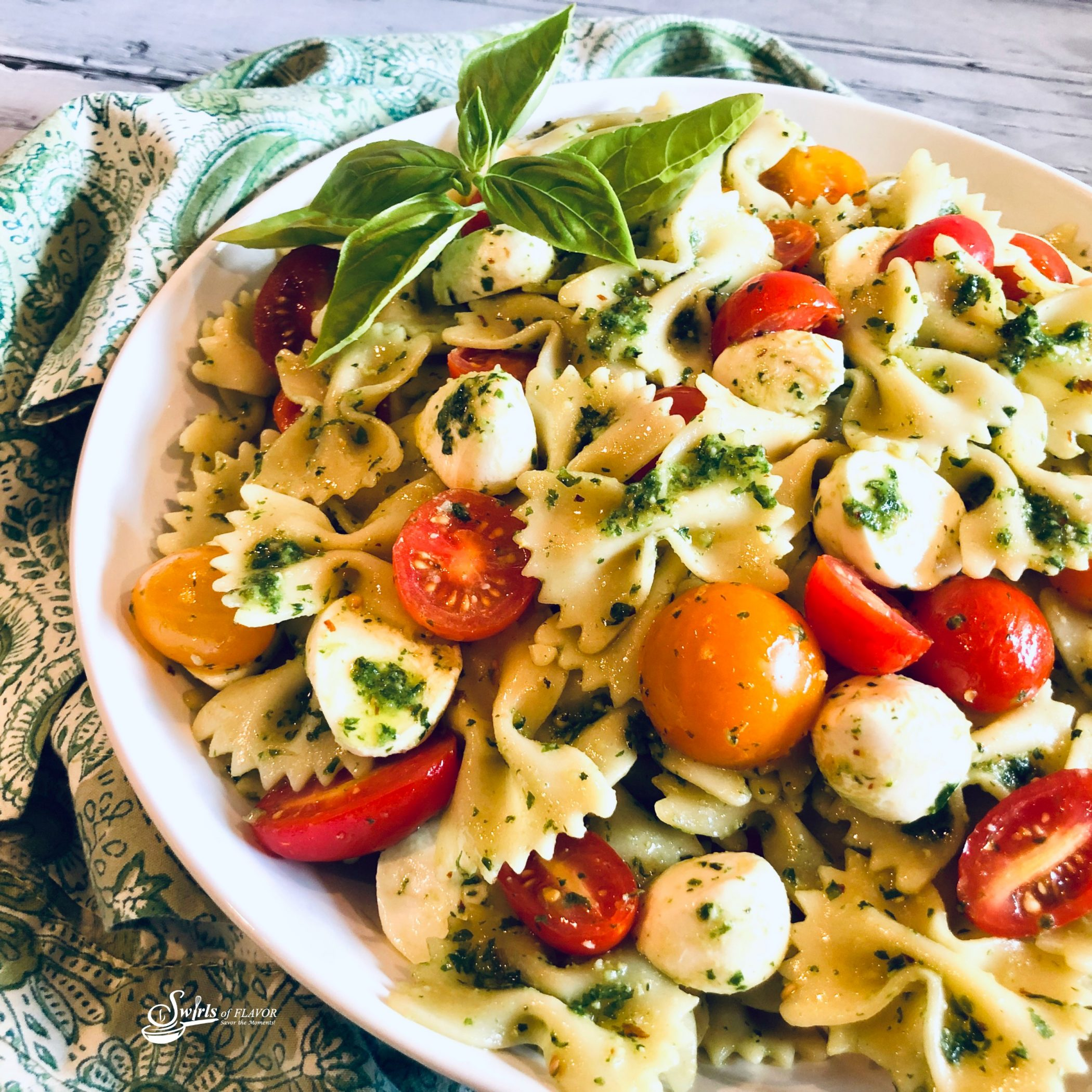 summer pasta salad in a round bowl