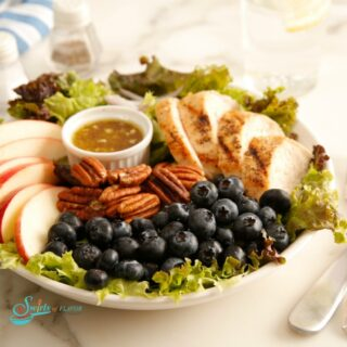Apple Pecan Chicken Salad arranged on bed of lettuce