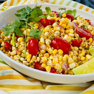 Summer corn salad with tomatoes in white oval dish