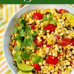 Corn tomato salad with cilantro and lime wedges