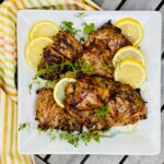 overhead photo of lemon oregano chicken with striped napkin