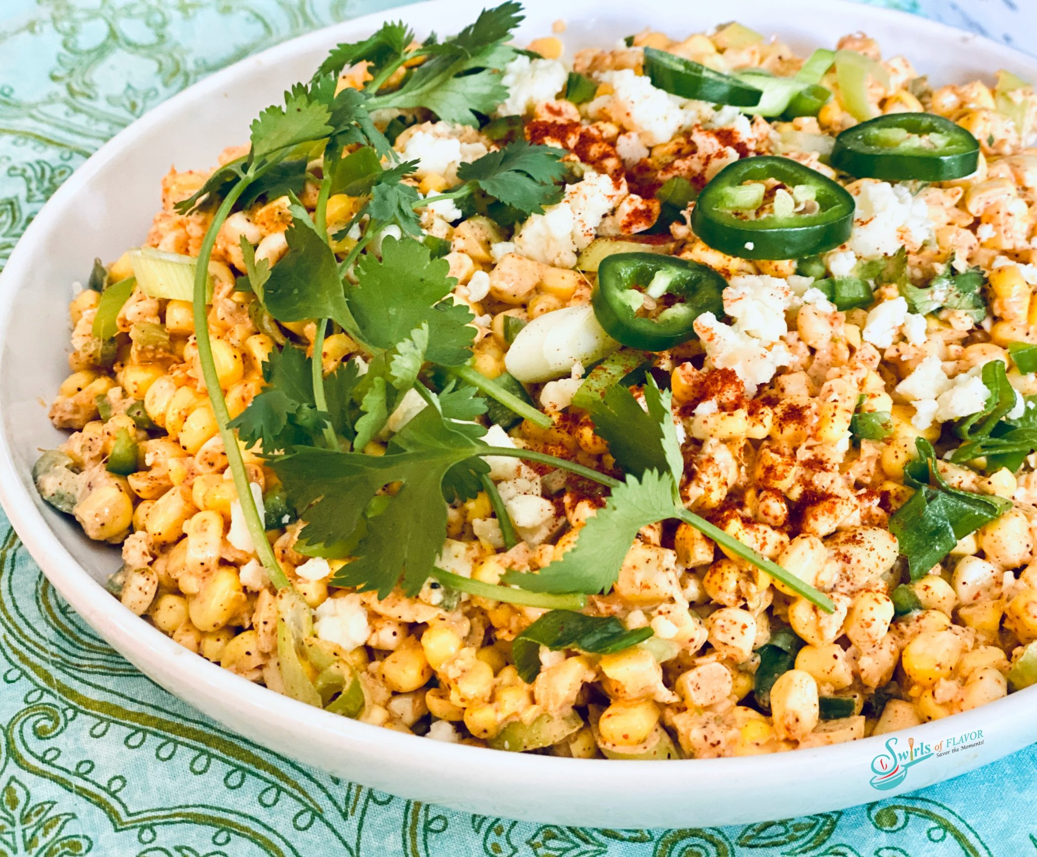 corn, jlapeno and cheese in white bowl