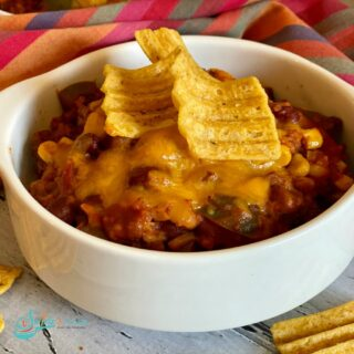 bowl of beef chili with corn chips on top