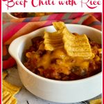bowl of beef chili with corn chips and text overlay