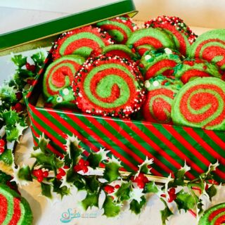 red and green pinwheel cookies in a cookie tin