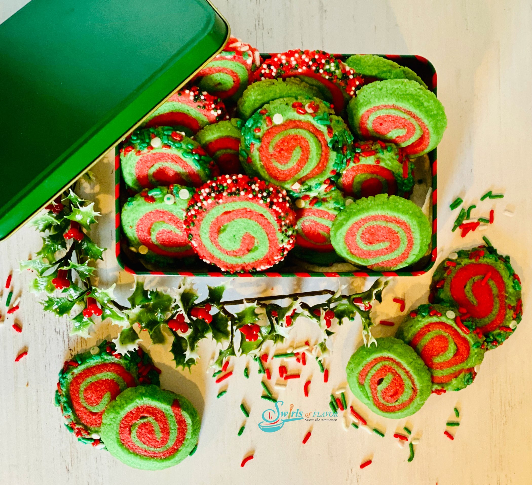 overhead picture of cookie tin filled with red and green spiral cookies